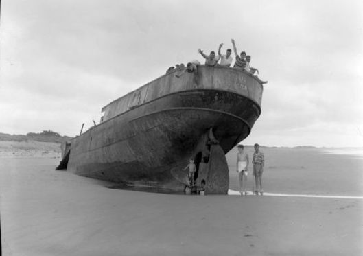 Trawler 'Phyllis', run ashore, near the mouth of the Waikanae River 1956