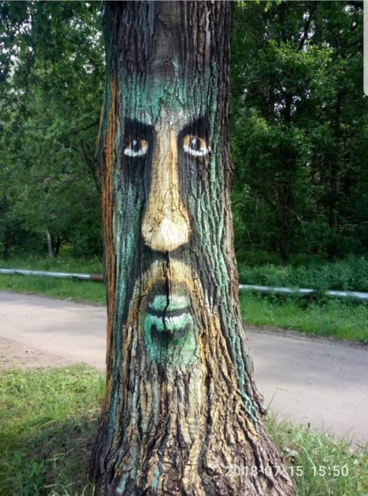 People of Lobnya town near Moscow paint their trees with faces to prevent them from being cut down
