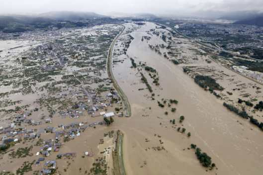 An aerial view shows residential areas flooded by the Chikuma river following Typhoon Hagibis in Nagano